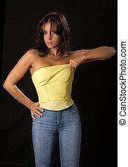 pull - lovely brunette pulling up leather corset