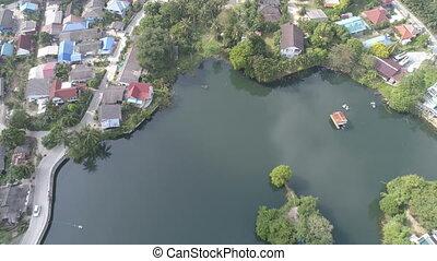 Pullback aerial shot of Kamala Lake Town in Phuket