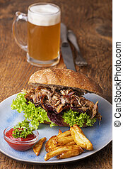 pulled pork in a bun with beer