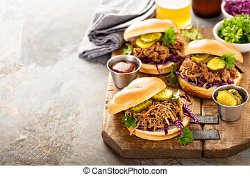 Pulled pork sandwiches with cabbage and pickles - Pulled...