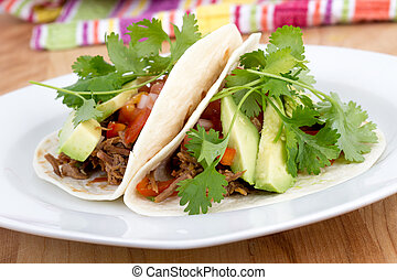 pulled pork soft taco with avocado and cilantro