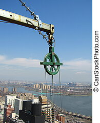 a pulley above the city of Mnahattan