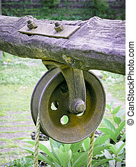 pulley used for drawing water out of a well