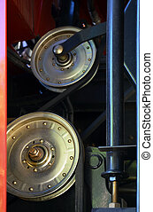 pulleys and belts on the engine of agricultural machinery