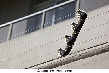 Pulleys Supporting Electric Fence of Residential Building -...