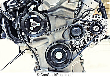 pulleys with belt in the car motor - toned shot of the...
