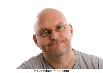 Pulling a face - Mature balding man looking very annoyed
