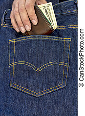 Pulling a wallet out of the back pocket of jeans