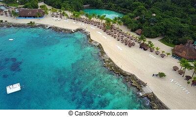 Pulling away from beach resort - Aerial view of beach resort...