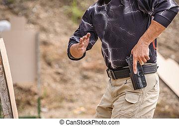 Pulling Gun Training. Outdoor Shooting Range