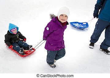 Pulling sister in sled
