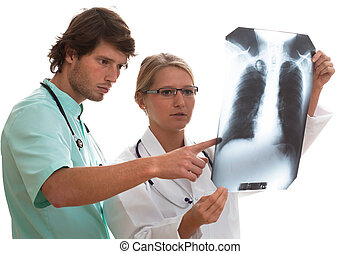 Pulmonologist and surgeon watching x-ray - Pulmonologist and...