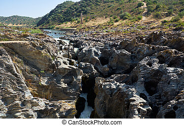 Pulo do Lobo (Wolf's leap) waterfall and cascade of river Guadiana, Alentejo, Portugal