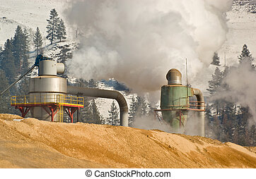 Smoke belches from stacks at a pulp mill in south-western British Columbia