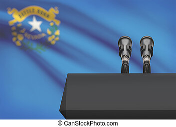Pulpit and two microphones with US state flag on background - Nevada