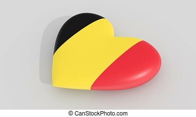Pulsating heart in the colors of Belgium flag, on a white...