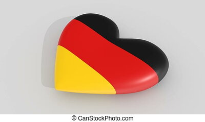Pulsating heart in the colors of Germany flag, on a white...