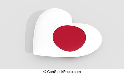 Pulsating heart in the colors of Japan flag, on a white...