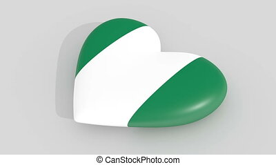 Pulsating heart in the colors of Nigeria flag, on a white...