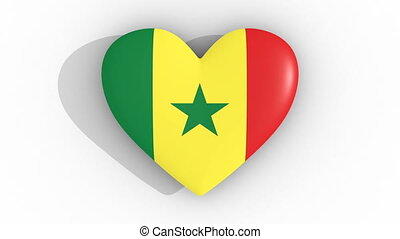 Pulsating heart in the colors of Senegal flag, on a white...