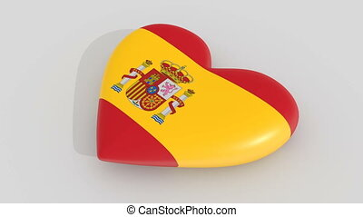 Pulsating heart in the colors of Spain flag, on a white...