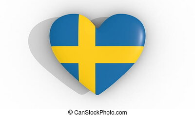 Pulsating heart in the colors of Sweden flag, on a white...