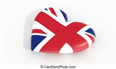 Pulsating heart in the colors of United Kingdom flag, on a...