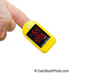 pulse oximeter on a mans finger