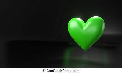 Pulsing green heart shape object on black text space. Loop able 3D animation.