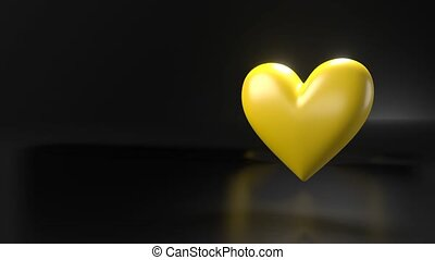 Pulsing yellow heart shape object on black text space. Loop able 3D animation.
