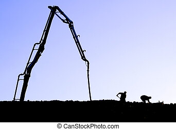 pump it up - Silhouette of workers and a concrete pump on...