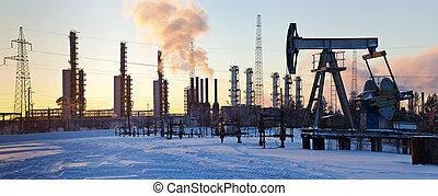 Pump jack and grangemouth refinery.