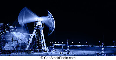 Pump jack and wellhead. Toned blue.