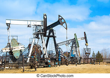 pump-jack group - Oil pump. Extraction of oil in Western ...