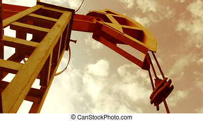 Pump jack - iconic symbol of oilfield - Pump jack in motion...