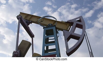 Pump jack lifting oil from well to the surface - iconic...
