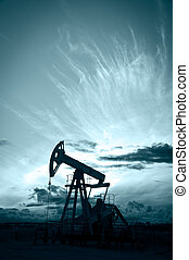 Pump jack. - Oil and gas industry. Silhouette oil pump on a...