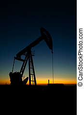 Pump jack silhouette at sunset