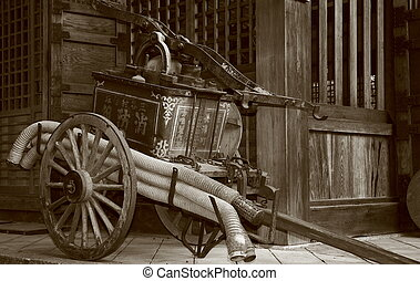 Pump - Sepia shot of an antique firefighting waterpump at a...