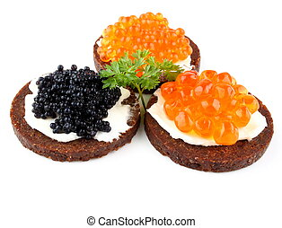 Pumpernickel bread with red and black caviar, close up