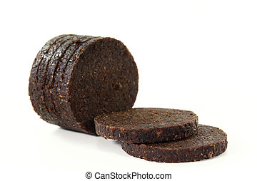 Pumpernickel - some slices of pumpernickel bread on a white ...