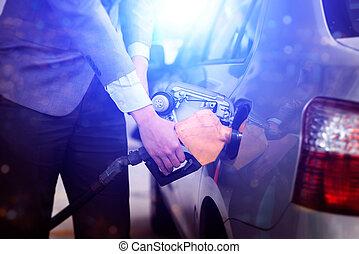 Pumping car petrol - Refilling gas. Close up of man pumping...