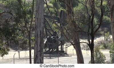 Pumping crude oil - An oil pump jack pumping in a state park