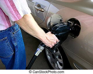 Pumping Gas (2) - Shows the proper way to hold the nozzle...