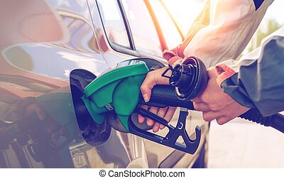 Pumping gas. Hand holding fuel nozzle.