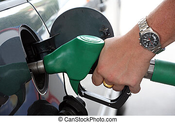 Pumping gas - A service station gas nozzle in the fuel...