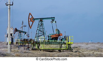Pumping oil in a power plant - A shot of an oil pump,...