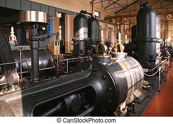 Vintage water pumping machine. Industrial machinery - building interior.
