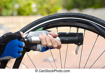 Pumping up repaired bike tyre