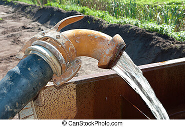 pumping water - pumping away groundwater in a basin